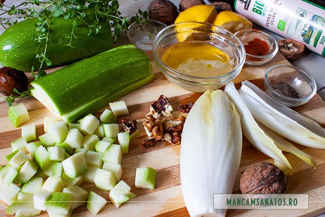 ingrediente pentru aperitiv festiv raw vegan, pe frunze de andive, cu oregano